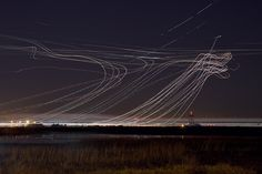 long exposure airplane photography from the san francisco international airport by terence chang