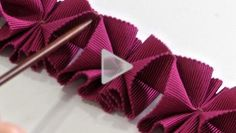 Watch to learn how to create a beautiful pleated trim from petersham ribbon.