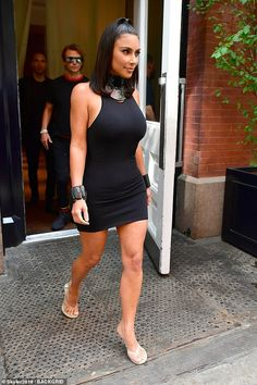 Kim Kardashian steps out in black dress with matching Wonder Woman style bracelets Kim Kardashian Show, Kardashian Style, Kardashian Jenner, Kim Kardashian Black Dress, Kardashian Fashion, Kylie Jenner, Plus Size Swimwear, Ladies Dress Design, Portrait