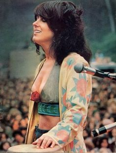 grace slick. love the cardigan with crop top and shorts. unique style