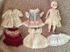 Image result for From Private Museum Paris Collection Antique Barefoot One of a Kind French All Bisque Mignonette Doll with Trousseau