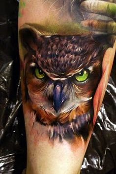 Amazing owl tattoo.  The detail is extraordinary.  I especially love the color and intensity of the eyes.  It's a beautiful tattoo.