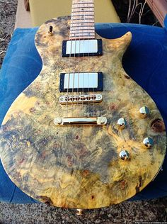 Carvin does buckeye burl!  http://carvinbbs.com/viewtopic.php?t=36682=0=asc=0