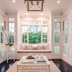 Beautiful architecture for the sunroom which includes a lovely windowseat #sunroom