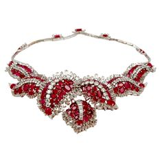 A Diamond and Burmese Ruby Necklace/Pin Mounted in Platinum, American, circa 1955.