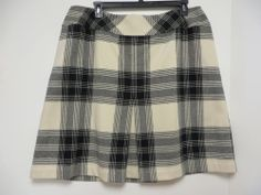 Talbots wool plaid skirt, passed down to me from my stepmother. I've been wearing this as much as I can this winter - it looks great with holiday sweaters.