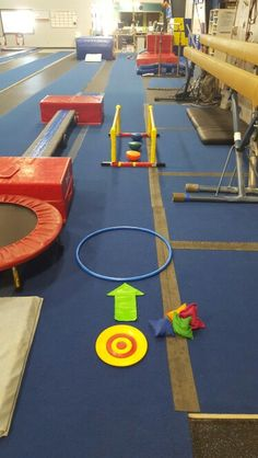 """Preschool Gymnastics: September 2015 Week 2 """"Day at the Pond!""""  1. Sit on target with a fish (bean bag) between feet, roll backward and drop the fish in the pond (hoop). 2. Walk across wobbly turtles (balance pods) and hold onto P bars for support if needed."""