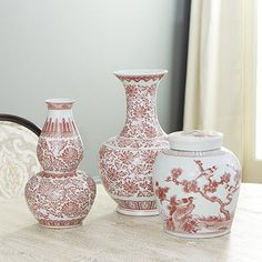 Copper-red porcelain dates back to 14th century China. But because cobalt was much easier to work with than copper, red and white porcelain was much rarer. These shapely silhouettes celebrate the honored tradition with timeless style. Use them to decorate for Christmas, and keep them out once the holidays are history. Rosewood Vases feature: Fill with stems & pair on mantel or buffetCollect all three vasesWatertight porcelain