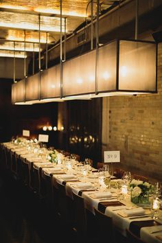 industrial wedding reception, photo by Chaz Cruz http://ruffledblog.com/soho-wedding-with-modern-and-industrial-touches #modernwedding #receptions