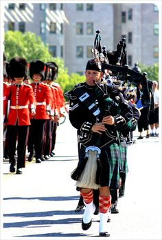 Regimental bagpipers during the Changing of the Guard at Parliament Hill in Ottawa, Ontario, Canada
