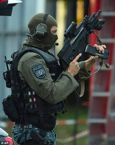 Police officer search a residential area near the Olympia shopping centre after a shooting was reported there in Munich, southern Germany, Friday, July (Matthias Balk/dpa via AP) Swat Police, Police Patrol, Police Officer, Military Gear, Military Police, Munich Shopping, German Police, Military Special Forces, Military Pictures