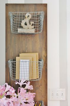 Like this idea for the bathroom - made whatever size fits best... and at the bottom, instead of the 3rd basket, put a towel hook or 2.  Fill the baskets with washcloths or sea sponges or jars with bath fizzes.