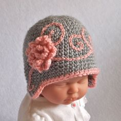Beanie Hat with FlowerShow stopper! Boutique style baby girl flapper hat features hand embroidered swirls across front and puffy crochet flower embellishment. Heather grey hat with dusty rose pink details. Photographers will find this beanie earfl...