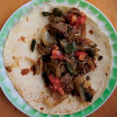 The beef cut of choice for California barbecue and grilling, tri-tip steak (also called Newport, Santa Maria, or triangle steak) comes from the lean bottom sirloin. Here it's sliced and seasoned with rosemary, chiles, garlic, and cumin in a tender filling for tacos.