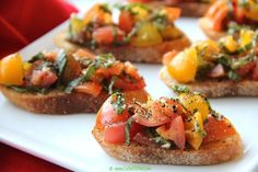 Heirloom Tomato and Basil Bruschetta. Perfect for a weekend brunch or an appetizer with drinks. Quick and easy to make and yet so delicious. Italian Antipasto, Grilled Bread, Heirloom Tomatoes, Balsamic Vinegar, Bruschetta, Vegan Vegetarian, Basil, Crisp, Brunch