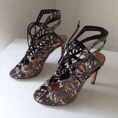 1 HOUR SALE Dolce Vita Helena Cut-out Sandal Cutouts & grommets accentuate the edgy feel of snakeskin Dolce Vita sandals. Lace up closure. Covered heel and rubber sole. 4 inch heel. BNIB & never worn.                                 PRICE WILL BE BACK TO $80 AFTER FLASH SALE ❗️ If these don't sell, I don't mind keeping . Dolce Vita Shoes