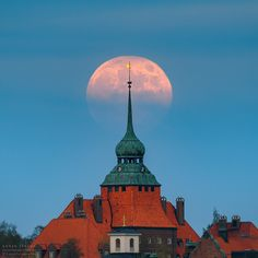 Rise of yesterday's full moon behind the town hall in Östersund, Sweden. The full Moon of May is also called the Flower Moon to signify the flowers that bloom during this month. The thin clouds made a nice gradient to the lower part of the Moon. Bokeh Photography, Night Photography, Kingdom Of Sweden, Beautiful Moon, World Photo, Town Hall, Shutter Speed, Dream Vacations, Empire State Building
