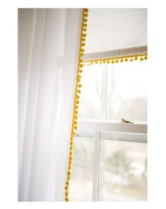 Yellow pom pom trim on white curtains. Sewing on the trim reminded me I am still a sewing amateur. Feeling defeated.