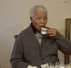 Nelson Mandela enjoying a cup of tea.
