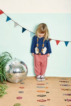 Make their room a party every day with a woven garland or in this case, a disco ball ;)