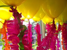 easy, cheap party decor. pink & yellow fringed balloons.