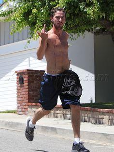 Shia LeBeouf giving the Finger while jogging