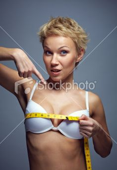 Woman measuring breast
