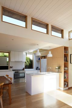 Looking for low maintenance, a cottage gets a cost effective extension, using no frills materials to get a casual, beachy space for family.