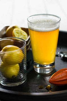 Ginger Shandy |  The ingredients:     1 ounce (30 ml) ginger liqueur     ½ ounce (15 ml) dry gin     ¾ ounce (22 ml) fresh lemon juice     1½ teaspoons simple syrup     3 ounces (90 ml) pale ale     3 ounces (90ml) ginger ale     twist of lemon peel for citrus oils