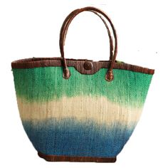 "Raffia is handwoven in a twill pattern then dip-dyed in pretty shades of blue and green.  Brown raffia trim and cotton lining.  Coconut button close and one interior pocket.  MEASUREMENTS: 13.5"" Height x 20"" Width at top x 23"" Length"