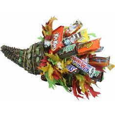 This festive Candy Bouquet is perfect for any Thanksgiving centerpiece. Loaded with plenty of Fun Size Candy & Chocolates to surprise the whole family. Fun Thanksgiving Games, Thanksgiving Centerpieces, Thanksgiving Table, Thanksgiving Recipes, Gift Card Bouquet, Diy Bouquet, Bouquets, Candy Gift Baskets, Mother's Day Gift Baskets