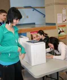Ashley St. Laurent casts a ballot in the Student Vote mock election at École du Sommet on Thursday.