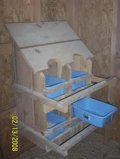 """""""Line"""" the nesting boxes with plastic bins for easy cleaning.....just dump, wash & refill with straw."""