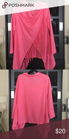 Top Coral top Long sleeve top with scoop neck and fringe that crosses over to a top button. Never worn. Tops Blouses
