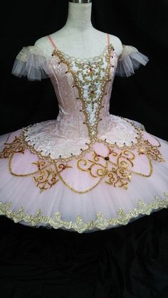 New Creation 2016! This exclusive pale pink tutu has been created for the role of the Sugar Plum Fairy in the ballet Nutcracker, and can also be used for The Sleeping Beauty ballet and other solos. The bodice is created with pink jaquard fabric, and features a white front, V-shaped insert decorated with gold appliques, pearls and crystals. The bodice look is completed by cute arm bands. The tutu skirt is pale pink fading to white and is richly decorated in gold. There is a tutu skirt made…