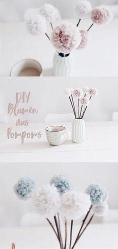 DIY DEKO - Blumen aus Pompoms selber machen. Mit Wolle und Naturmaterialien basteln. Tischdekoration.