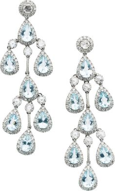 Aquamarine, Diamond, White Gold Earrings.  The earrings feature pear-shaped aquamarine weighing a total of approximately 3.00 carats, enhanced by rose-cut aquamarine weighing a total of approximately 1.75 carats, surrounded by full-cut diamonds weighing a total of approximately 2.25 carats, set in 18k white gold