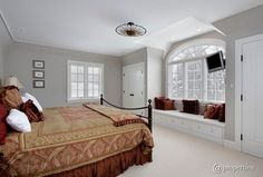 Traditional Master Bedroom with Window seat, Custom Built-in Bench, Custom cushions bench cushion - basic, High ceiling