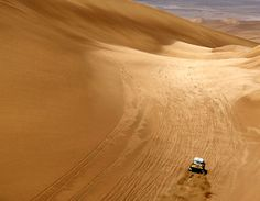 This is from the Dakar rally racing in So. America. I want to witness this and/or ride along with this!