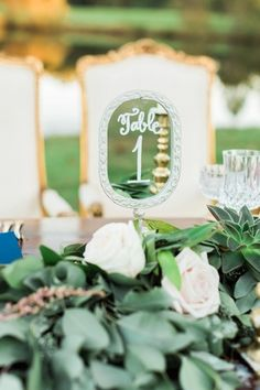 Unique wedding table number idea - repurposed hand mirrors {Alicia Wiley Photography}