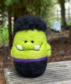 needle felted frankenstein with polymer clay teeth