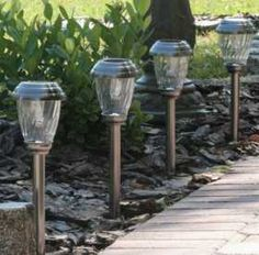 Light the way with the Smart Solar Charleston 6 Pack Solar Lights. These path lights are housed in sturdy stainless steel, and automatically switch. Mason Jar Light Fixture, Mason Jar Lighting, Light Fixtures, White Led Lights, Jar Lights, Solar Led, Diy Solar, Garden Path Lighting, Outdoor Lighting