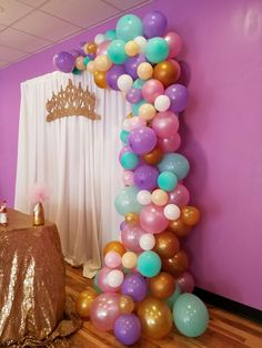 Balloon garland, princess, crown, baby shower, elegant, pink purple blue and gold, tutu skirt. Gold tablecloth, simple and elegant