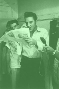 "(August 6, 1956) Elvis in Lakeland, FL.... checking out Anne Rowe's fullpage article (about his performance in Tampa) in the St. Petersburg Times that was published that day. Needless to say, and unlike most of the articles written about him at this stage of his career, the female reporter gave him two thumbs up, claiming ""Presley is the biggest thing in show business today""."