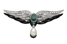 An early 20th century natural pearl, emerald, and diamond wing brooch The collet-set oval mixed-cut emerald, between two single-cut diamond wings of openwork design, suspending a collet-set similarly-cut diamond and a 9.0mm natural pearl drop, millegrain-set throughout, diamonds approx. 0.40ct total, width 5.5cm