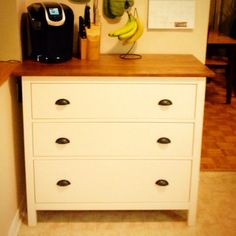 Hemnes Ikea hack! I turned my dresser into a butcher block. It's solid pine with a white stain. Step 1: sand the stain off the top & bottom of the dresser top, as it hangs over. *important: wear a mask, stain may contain lead & you don't want to breath it in* Step 2: Stain & seal (minwax) both sides *note it is not food safe, cutting board needed* Step 3: Build ikea dresser. I added wood glue to drawers for extra support. Step 4: Add desired hardware. Two new holes were drilled for these :)