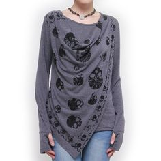 I love this. Not so much with jeans... I am too goth for that. Why won't the link work? Anyone know where I can purchase this top?? If not, I suppose I could work out how to knit one from cashmere.