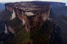 Mount Roraima (2,810 m/9,219 feet) is the highest of tepuis, sandstone mesas (table mountains) scattered across the Guyana Highlands of northeastern South America. This impressive geological formation, one of the world's oldest, is shared by Venezuela, Guyana and Brazil.