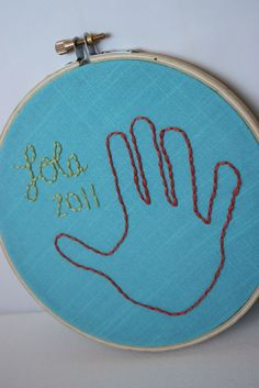 embroidery hand prints, could do tiny baby one for first Christmas ornament? maybe it would be small enough.