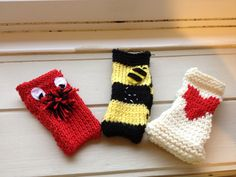 Knitted iPhone cases. From left 'Big Red Nose' 'Bees Knees' 'Lovely Jubbly'